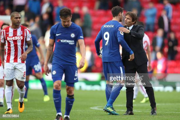 Alvaro Morata of Chelsea and Antonio Conte manager of Chelsea celebrate at full time during the Premier League match between Stoke City and Chelsea...