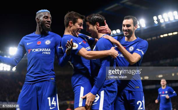Alvaro Morata of Chelsea celebrates scoring his sides first goal with his Chelsea team mates during the Premier League match between Chelsea and...