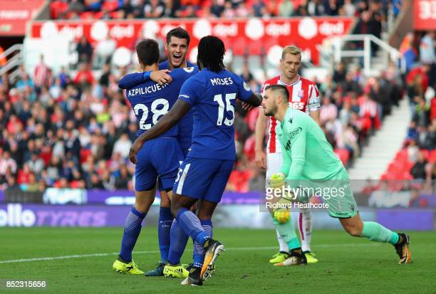 Alvaro Morata of Chelsea celebrates scoring his sides fourth goal with his Chelsea team mates during the Premier League match between Stoke City and...
