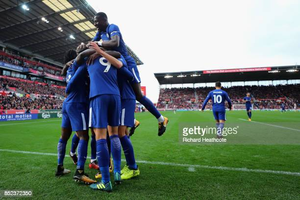 Alvaro Morata of Chelsea celebrates scoring his sides thir goal with his Chelsea team mates during the Premier League match between Stoke City and...