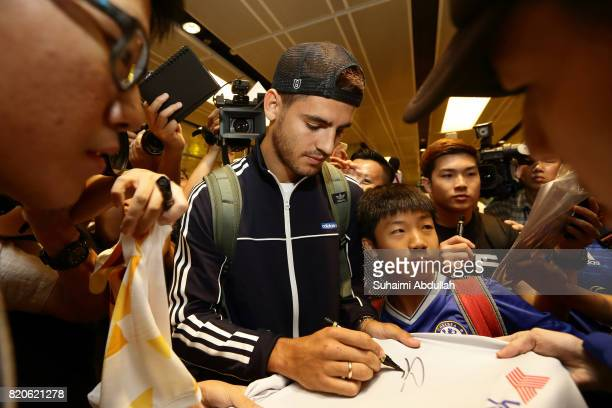 Alvaro Morata of Chelsea FC signs autograph for fans after he arrives at Changi International Airport ahead of the International Champions Cup on...