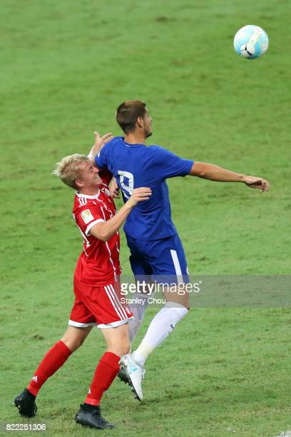 Alvaro Morata of Chelsea is checked by Niklas Dorsch of Bayern Munich during the International Champions Cup match between Chelsea FC and FC Bayern...