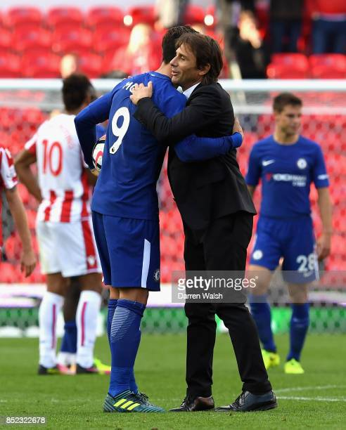 Alvaro Morata of Chelsea is congratulated his team's 40 victory and his hat trick by manager Antonio Conte after the Premier League match between...