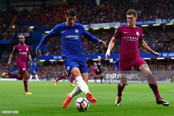Alvaro Morata of Chelsea is put under pressure from John Stones of Manchester City during the Premier League match between Chelsea and Manchester...