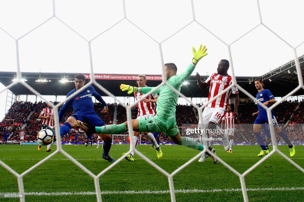 Alvaro Morata of Chelsea scores his sides fourth goal past Jack Butland of Stoke City during the Premier League match between Stoke City and Chelsea at Bet365 Stadium on September 23, 2017 in Stoke on Trent, England.