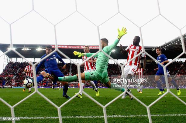 Alvaro Morata of Chelsea scores his sides fourth goal past Jack Butland of Stoke City during the Premier League match between Stoke City and Chelsea...
