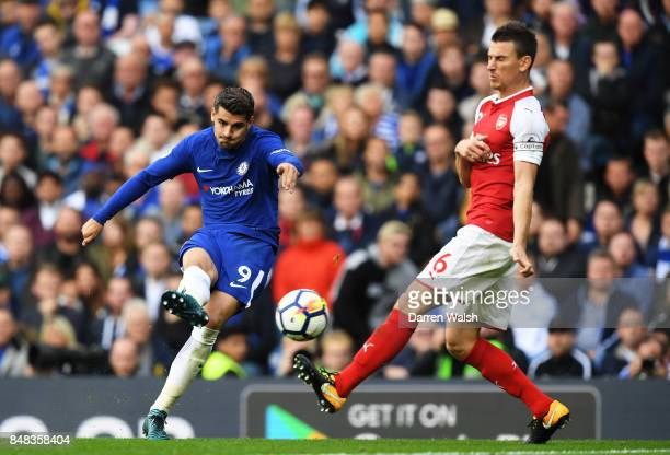 Alvaro Morata of Chelsea shoots as Laurent Koscielny of Arsenal attempts to block during the Premier League match between Chelsea and Arsenal at...