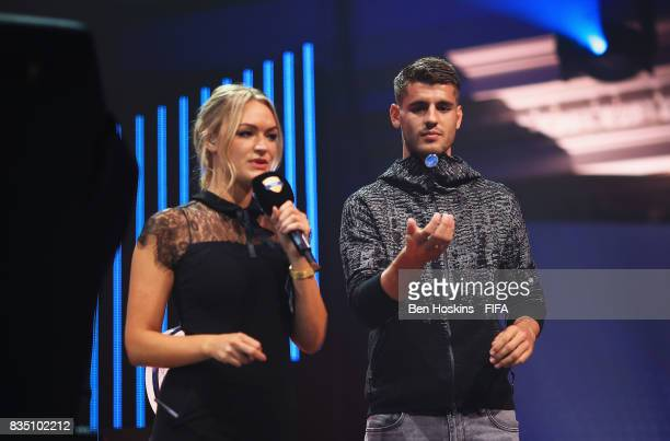 Alvaro Morata of Chelsea tosses the coin with presenter Laura Woods during day three of the FIFA Interactive World Cup 2017 Grand Final at Central...