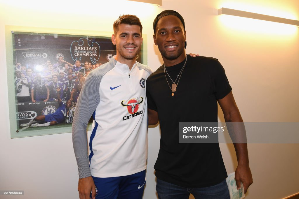 Alvaro Morata of Chelsea with Ex Chelsea player Didier Drogba after a training session at Chelsea Training Ground on August 23, 2017 in Cobham, England.