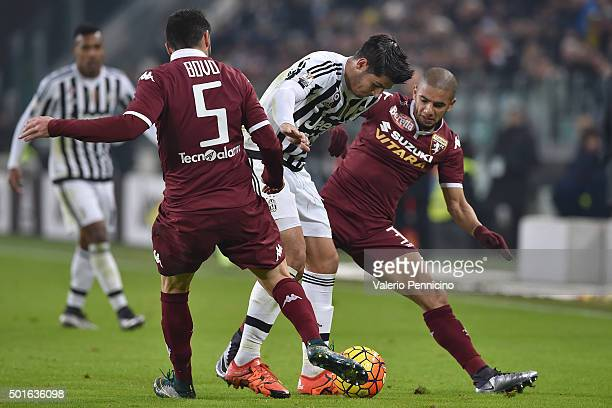 Alvaro Morata of FC Juventus is challenged by Bruno Peres and Cesare Bovo of Torino FC during the TIM Cup match between FC Juventus and Torino FC at...
