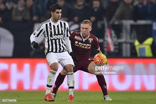 Alvaro Morata of FC Juventus is challenged by Kamil Glik of Torino FC during the TIM Cup match between FC Juventus and Torino FC at Juventus Arena on...