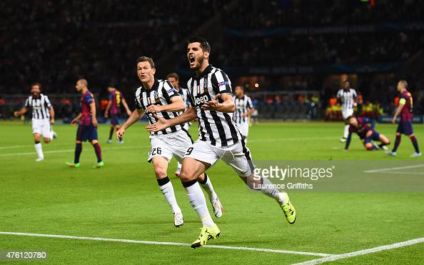 Alvaro Morata of Juventus celebrates scoring his team's first goal with Stephan Lichtsteiner during the UEFA Champions League Final between Juventus...