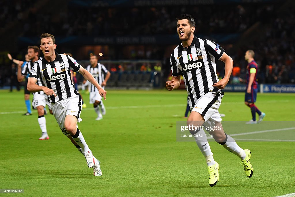 Alvaro Morata of Juventus celebrates scoring his team's first goal with Stephan Lichtsteiner during the UEFA Champions League Final between Juventus and FC Barcelona at Olympiastadion on June 6, 2015 in Berlin, Germany.