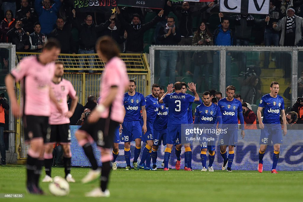 Alvaro Morata of Juventus celebrates with team mates after scoring the opening goal during the Serie A match between US Citta di Palermo and Juventus...