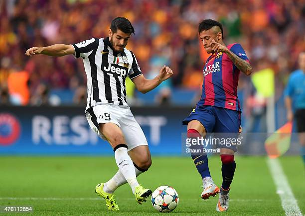 Alvaro Morata of Juventus challenges Neymar of Barcelona during the UEFA Champions League Final between Juventus and FC Barcelona at Olympiastadion...