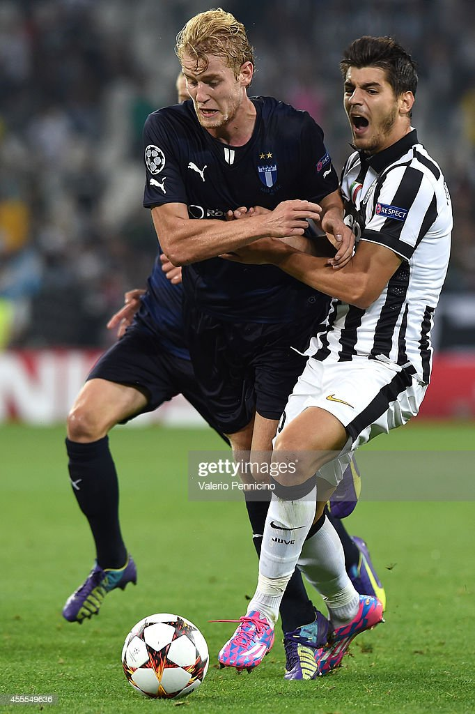 Alvaro Morata (R) of Juventus clashes with Filip Helander of Malmo FF during the UEFA Champions League Group A match between Juventus and Malmo FF on September 16, 2014 in Turin, Italy.