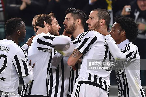 Alvaro Morata of Juventus FC celebrates after scoring the opening goal from the penalty spot with team mates during the TIM Cup match between...