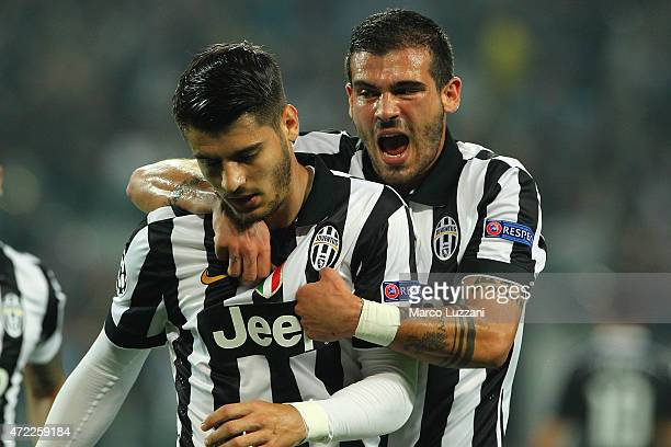 Alvaro Morata of Juventus FC celebrates with his teammate Stefano Sturaro after scoring the opening goal during the UEFA Champions League semi final...