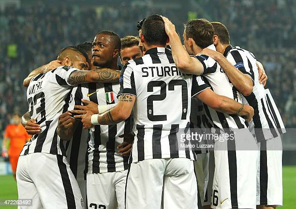 Alvaro Morata of Juventus FC celebrates with his teammates after scoring the opening goal during the UEFA Champions League semi final match between...