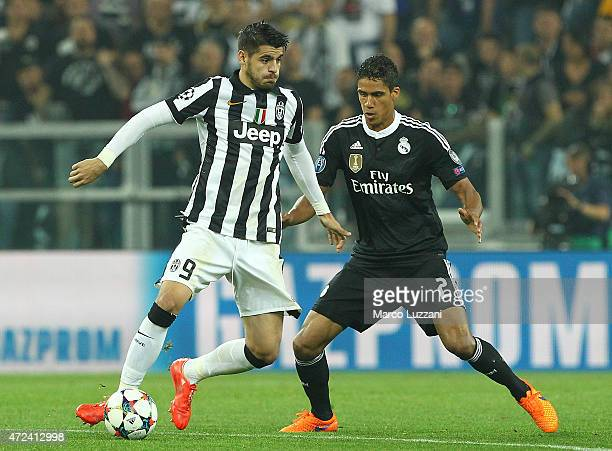 Alvaro Morata of Juventus FC competes for the ball with Raphael Varane of Real Madrid CF during the UEFA Champions League semi final match between...