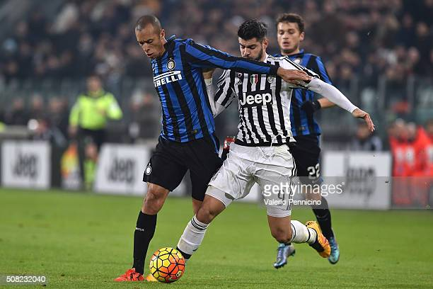 Alvaro Morata of Juventus FC competes with Joao Miranda of FC Internazionale Milano during the TIM Cup match between Juventus FC and FC...