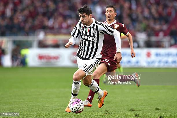 Alvaro Morata of Juventus FC in action against Giuseppe Vives of Torino FC during the Serie A match between Torino FC and Juventus FC at Stadio...