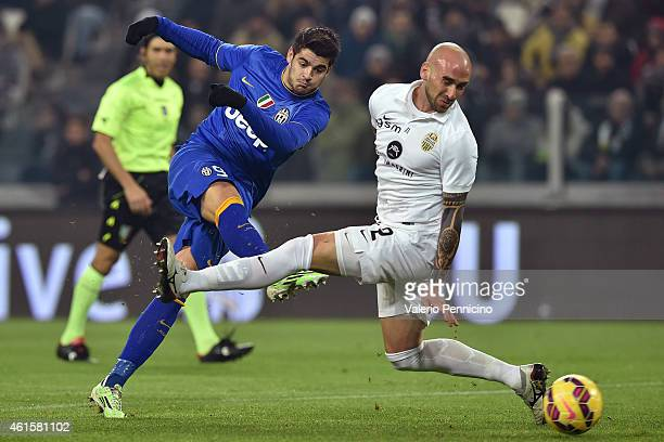 Alvaro Morata of Juventus FC in action against Guillermo Daniel Rodriguez Perez of Hellas Verona FC during the TIM Cup match between Juventus FC and...