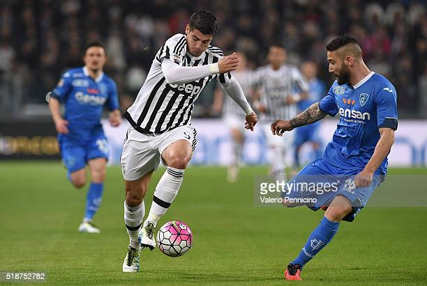 Alvaro Morata of Juventus FC in action against Lorenzo Tonelli of Empoli FC during the Serie A match between Juventus FC and Empoli FC at Juventus...