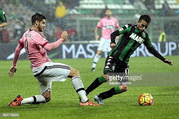 Alvaro Morata of Juventus FC in action against Nicola Sansone of US Sassuolo Calcio during the Serie A match between US Sassuolo Calcio and Juventus...