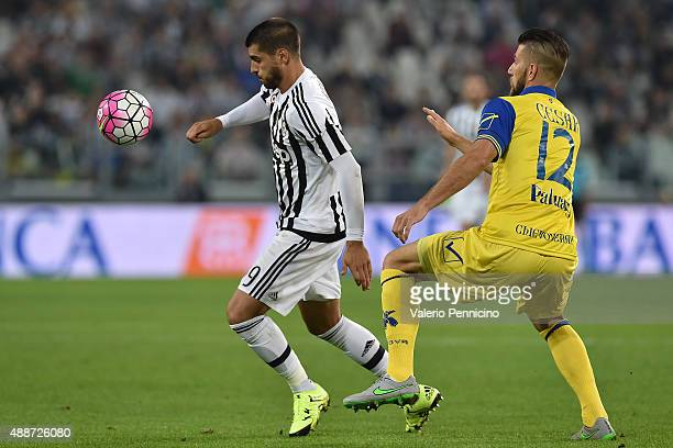 Alvaro Morata of Juventus FC is challenged by Bostjan Cesar of AC Chievo Verona during the Serie A match between Juventus FC and AC Chievo Verona at...