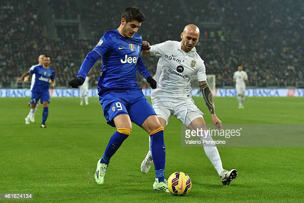 Alvaro Morata of Juventus FC is challenged by Guillermo Daniel Rodriguez of Hellas Verona FC during the TIM Cup match between Juventus FC and Hellas...