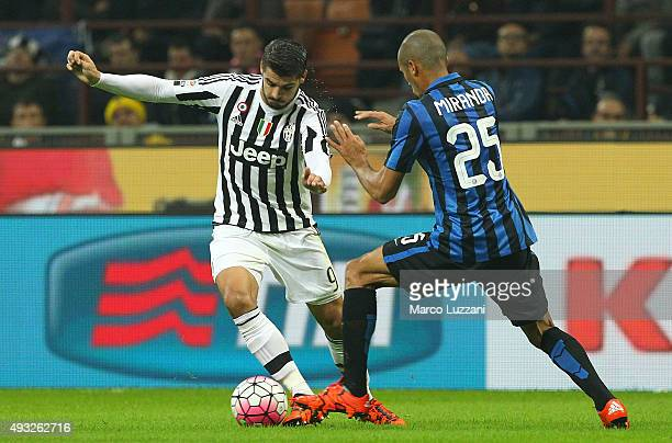 Alvaro Morata of Juventus FC is challenged by Joao Miranda of FC Internazionale Milano during the Serie A match between FC Internazionale Milano and...