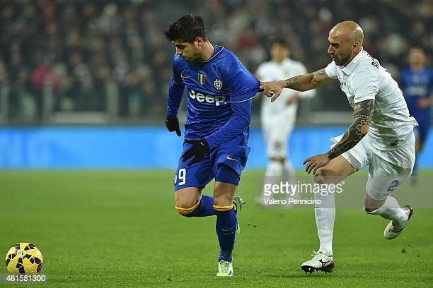 Alvaro Morata of Juventus FC is pulled by his shirt by Guillermo Daniel Rodriguez Perez of Hellas Verona FC during the TIM Cup match between Juventus...
