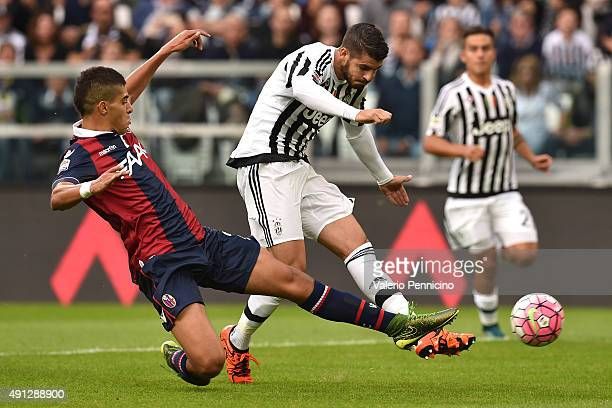 Alvaro Morata of Juventus FC is tackled by AdamÊMasina of Bologna FC during the Serie A match between Juventus FC and Bologna FC at Juventus Arena on...