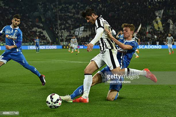 Alvaro Morata of Juventus FC is tackled by Daniele Rugani of Empoli FC during the Serie A match between Juventus FC and Empoli FC at Juventus Arena...