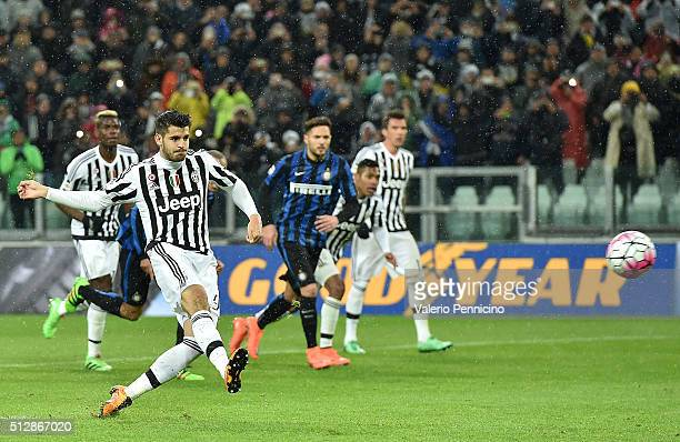 Alvaro Morata of Juventus FC scores his goal from the penalty spot during the Serie A match between Juventus FC and FC Internazionale Milano at...