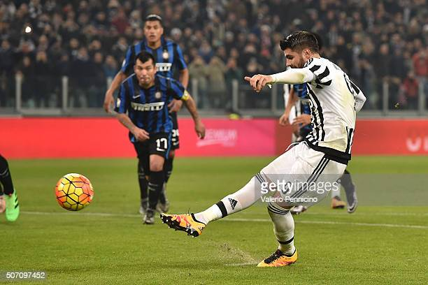 Alvaro Morata of Juventus FC scores the opening goal from the penalty spot during the TIM Cup match between Juventus FC and FC Internazionale Milano...