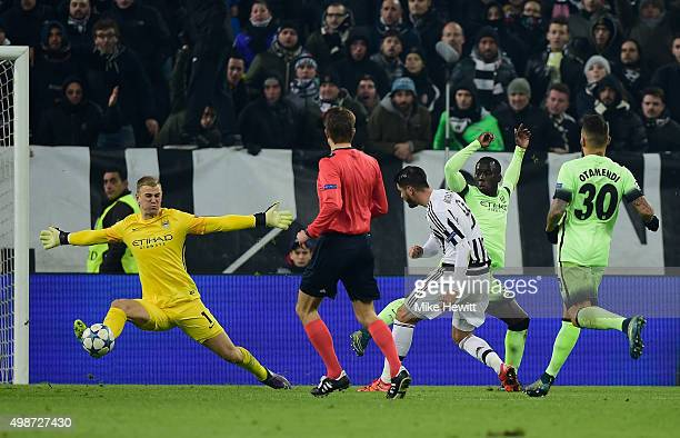 Alvaro Morata of Juventus has his shot on goal saved by goalkeeper Joe Hart of Manchester City during the UEFA Champions League group D match between...