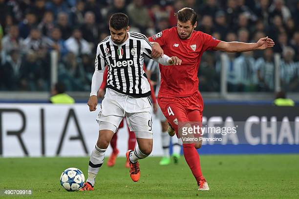 Alvaro Morata of Juventus is challenged by Grzegorz Krychowiak of Sevilla during the UEFA Champions League group E match between Juventus and Sevilla...
