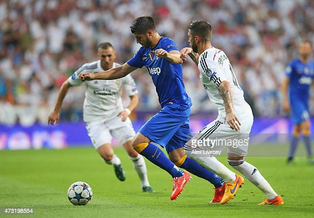 Alvaro Morata of Juventus is challenged by Sergio Ramos of Real Madrid during the UEFA Champions League Semi Final second leg match between Real...
