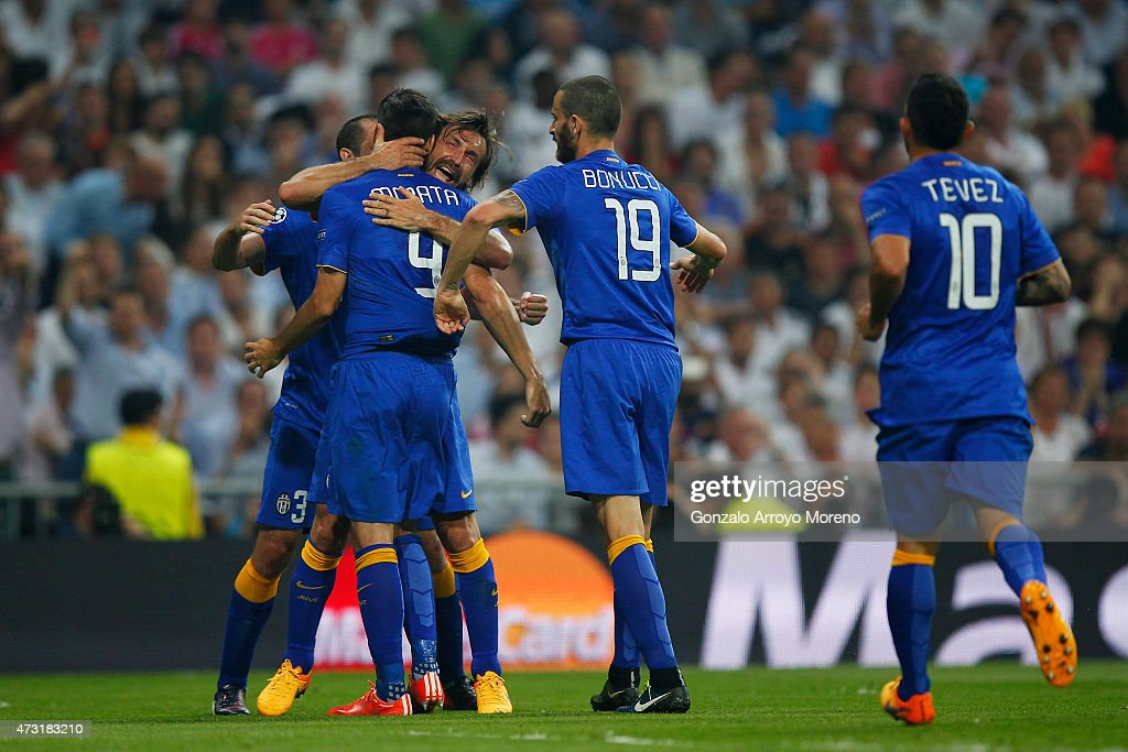 Alvaro Morata of Juventus is congratulated by teammates after scoring a goal to level the scores at 11 during the UEFA Champions League Semi Final...