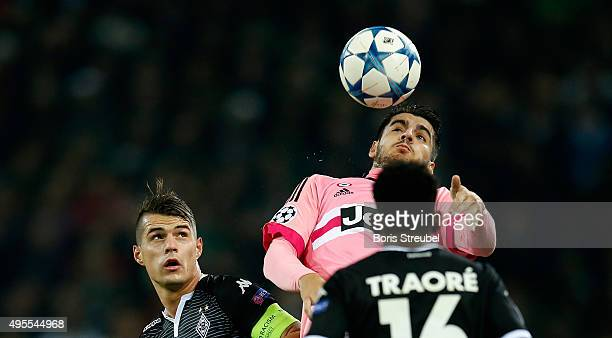 Alvaro Morata of Juventus jumps for a header with Granit Xhaka of Borussia Monchengladbach during the UEFA Champions League Group D match between VfL...