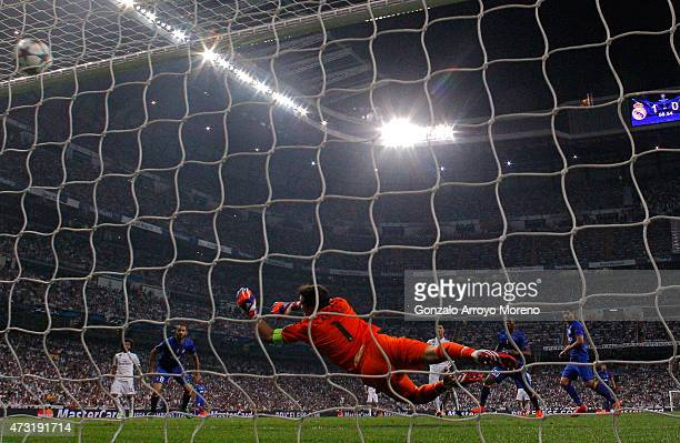 Alvaro Morata of Juventus scores a goal past the outstretched Iker Casillas of Real Madrid to level the scores at 11 during the UEFA Champions League...
