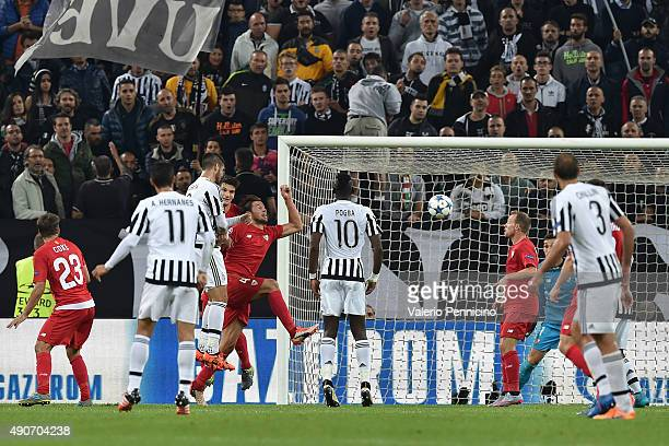 Alvaro Morata of Juventus scores the opening goal during the UEFA Champions League group E match between Juventus and Sevilla FC on September 30 2015...