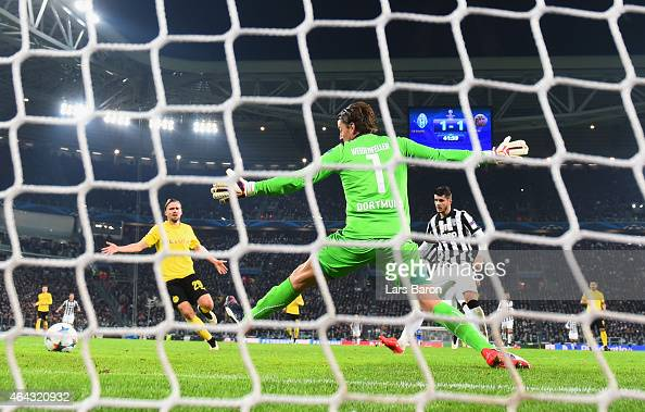 Alvaro Morata of Juventus scores their second goal past goalkeeper Roman Weidenfeller of Borussia Dortmund during the UEFA Champions League Round of...