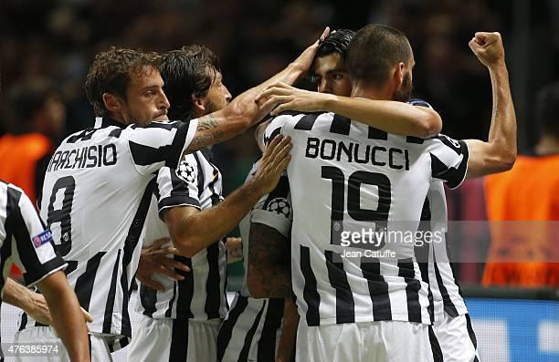 Alvaro Morata of Juventus Turin celebrates his goal with Claudio Marchisio and Leonardo Bonucci of Juventus Turin during the UEFA Champions League...