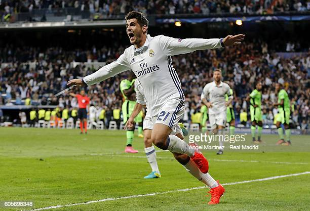 Alvaro Morata of Real Madrid celebrates after scoring his team's second goal during the UEFA Champions League Group F match between Real Madrid CF...