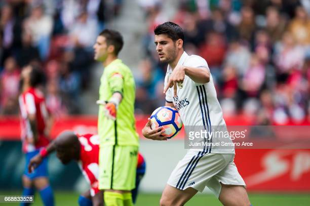 Alvaro Morata of Real Madrid celebrates after scoring his team's second goal during the La Liga match between Real Sporting de Gijon and Real Madrid...
