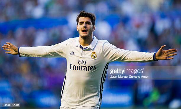 Alvaro Morata of Real Madrid celebrates after scoring his team's third goal during the La Liga match between Deportivo Alaves and Real Madrid at...