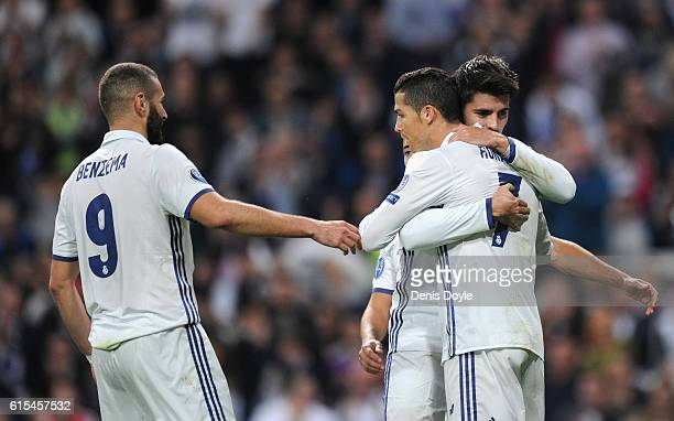 Alvaro Morata of Real Madrid celebrates scoring his team's fifth goal with his team mates Karim Benzema and Cristiano Ronaldo during the UEFA...